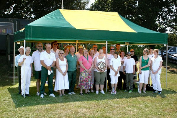 Councillor Mrs Gates with members of Sway Bowmen under the new mini marquee.