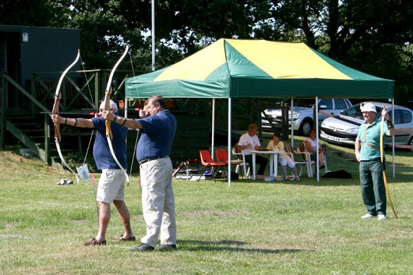 Robin Jackson (left) and Tony Baker (right) from NM Lions Club shoot the first arrows of The White Rose Shoot.